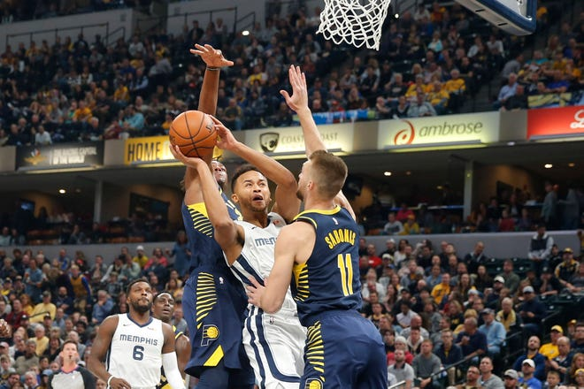 Oct 17, 2018; Indianapolis, IN, USA; Memphis Grizzlies forward Kyle Anderson (1) shoots against Indiana Pacers forward Damantas Sabonis (11) during the first quarter at Bankers Life Fieldhouse.