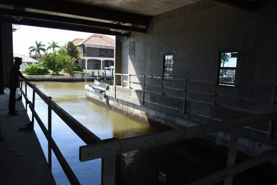 The internal boathouse will house both a 30-ft. and a 50-ft. boat. After years of discussion, a home with a cut-in boat garage is taking shape on Marco Island.