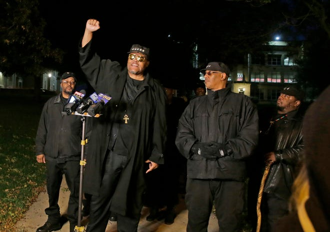 """""""No justice, no peace,"""" says King Rick, a member of The Original Black Panthers, who held a news conference outside Shorewood High School on Wednesday. Speaking for the group, King denounced any effort to prevent black students from expressing concern about the use of a racial slur in a planned school production of """"To Kill a Mockingbird."""" The school canceled the dress rehearsal, which was planned only for family members of the cast and crew. The public production of thw play was cancelled, then put back on, then cancelled again."""