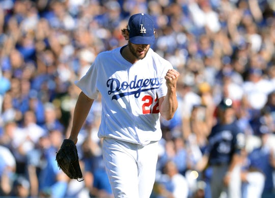 Clayton Kershaw strikes out Jesus Aguilar with the bases loaded.
