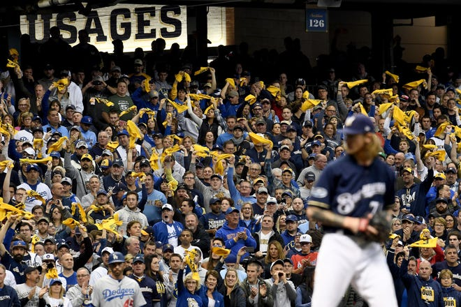 Fans cheer Josh Hader as he prepares to throw a pitch during Game 1 of the NLCS at Miller Park on Oct. 12.
