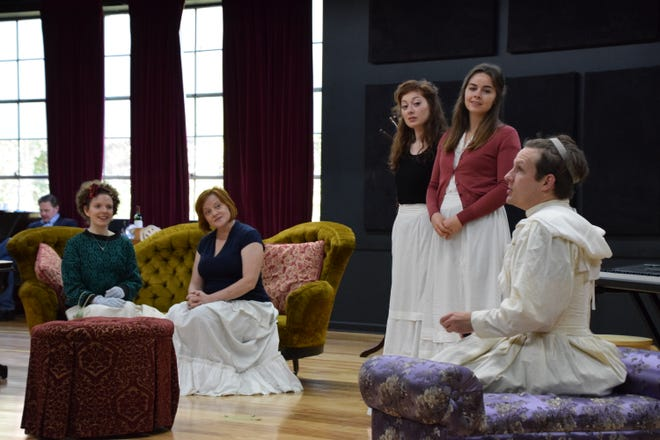 """Babberley (played by Seamus Mulcahy, right) who is pretending to be Charley's aunt, confronts Charley's real aunt (Erika Rolfsrud, sitting right). in this rehearsals of a scene from """"Charley's Aunt.""""  The Victorian comedy will be presented by Shakespeare Theatre of NJ in Madison now through November 18."""