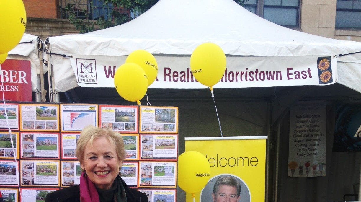 Karen Spitzner of Weichert's Morristown East office was one of the sales associates who answered questions and provided other information about the real estate market at the recent Festival on the Green.