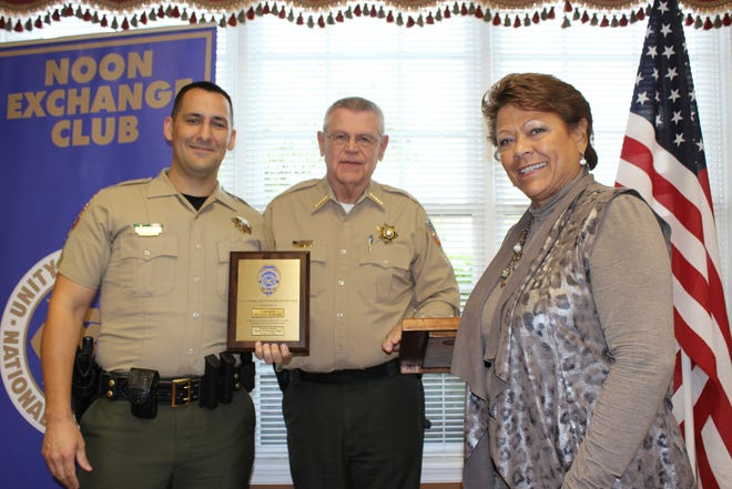 Cpl. Michael Rodgers accepts the Officer of the Year Award from the Murfreesboro Noon Exchange Club from Sheriff Mike Fitzhugh and Exchange Club member Shirley Schuette.