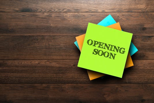 Opening Soon The Phrase Is Written On Multi Colored Stickers On A Brown Wooden Background Business Concept Strategy Plan Planning