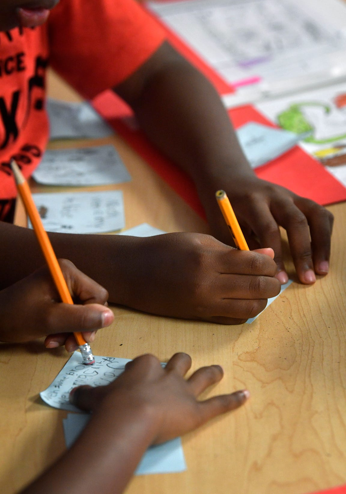 Children complete assignments at Explore charter school in East Nashville. Despite cuts to other programs, the Martha O'Bryan Center is expanding its charter school fundraising.