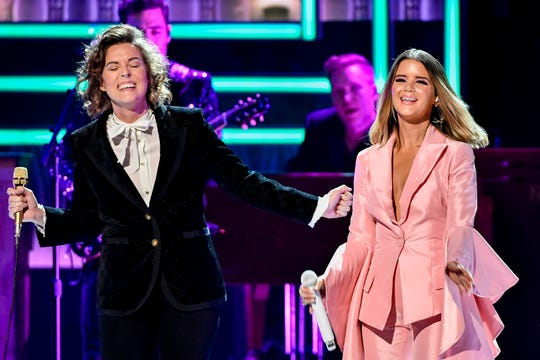 Maren Morris, right, and Brandi Carlile, left, perform during the CMT Artists of the Year ceremony at the Schermerhorn Symphony Center in Nashville, Tenn., Wednesday, Oct. 17, 2018.