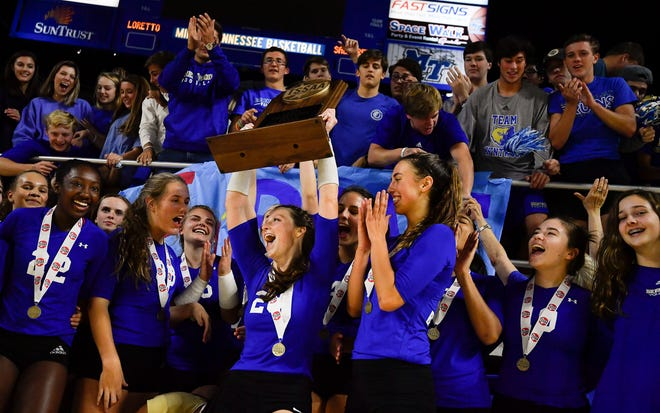 Brentwood players celebrate their win over Siegel in the Class AAA state volleyball championships Thursday at MTSU's Murphy Center.