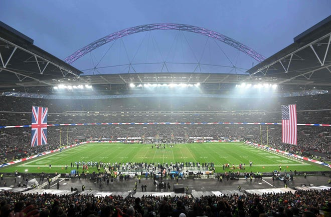 General overall view of Wembley Stadium with British and United States flags during the playing of the national anthem before a game between the  Seahawks and Raiders on Oct 14.