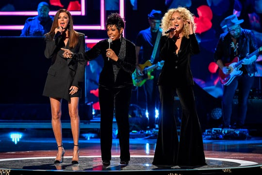 Karen Fairchild, left, Gladys Knight, center, and Kimberly Schlapman, right, perform during the CMT Artists of the Year ceremony at the Schermerhorn Symphony Center in Nashville, Tenn., Wednesday, Oct. 17, 2018.