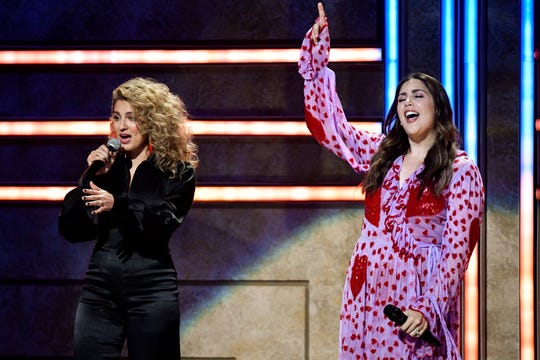 Tori Kelly, left, and Hillary Scott, right, perform during the CMT Artists of the Year ceremony at the Schermerhorn Symphony Center in Nashville, Tenn., Wednesday, Oct. 17, 2018.