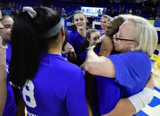 Brentwood coach Barbara Campbell hugs her players as they celebrate their win over Siegel on Thursday.