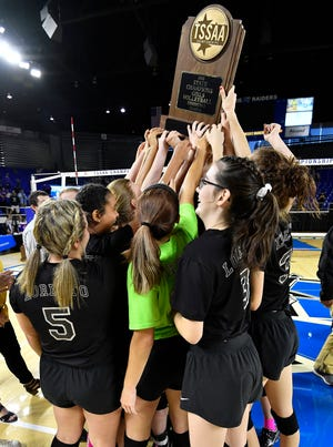 Loretto players celebrate after defeating Sale Creek in the Class A state volleyball championships on Thursday at MTSU's Murphy Center.