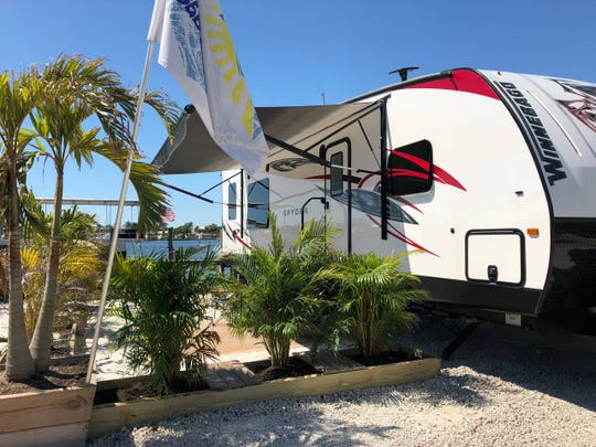 This 31-foot brand new Winnebago RV sitting right on the intracoastal in Fort Myers Beach Florida is available for rent through Airbnb.