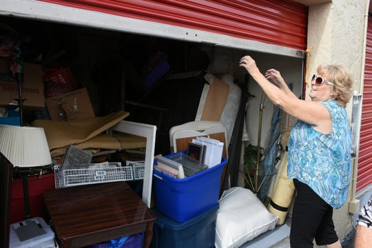 Wings of Hope co-founder Peggy Moberg shuts a storage unit where the group keeps donated items. The local nonprofit assistance group, that sprang up after Hurricane Irma, will hold a free fall festival Saturday, Oct. 27 at Sugden Park.