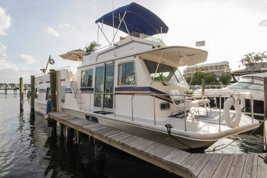 A 52-foot houseboat on the Naples Bay in downtown Naples is available for rent through Airbnb.