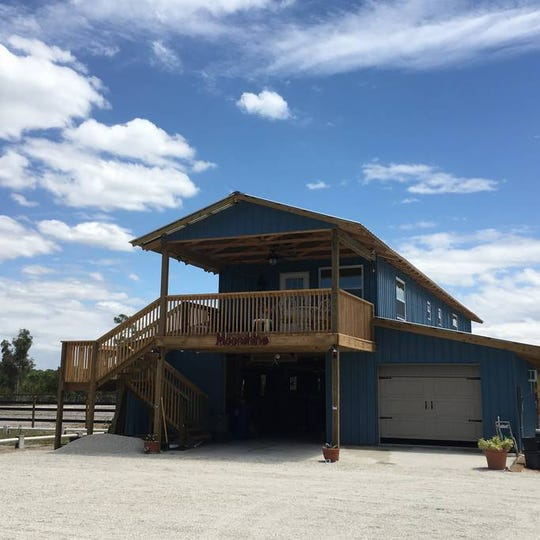 Moonshine Acres Tropical Horse Farm is  in Saint James City and rents out a second story apartment above an eight-horse stall through Airbnb.