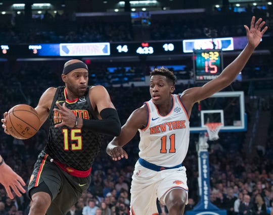 Atlanta Hawks guard Vince Carter (15) drives to the basket against New York Knicks guard Frank Ntilikina (11) during the first half of an NBA basketball game, Wednesday, Oct. 17, 2018, at Madison Square Garden in New York.