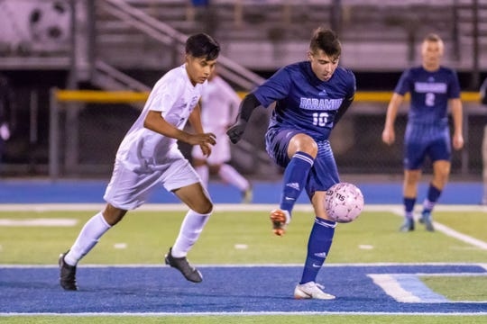 Paramus #10 Justin Behnke working for the ball against Hackensack #7 Victor Amendano on Wednesday, October 17, 2018.