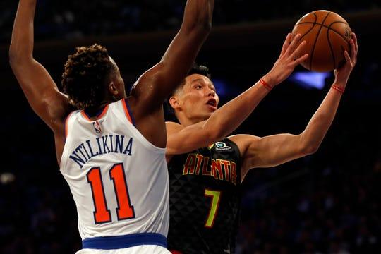 Oct 17, 2018; New York, NY, USA; Atlanta Hawks guard Jeremy Lin (7) drives to the basket past New York Knicks guard Frank Ntilikina (11) during the first half at Madison Square Garden.