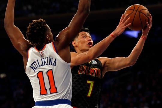Oct 17, 2018; New York, NY, USA; Atlanta Hawks guard Jeremy Lin (7) drives to the basket past New York Knicks guard Frank Ntilikina (11) during the first half at Madison Square Garden.