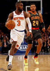 Oct 17, 2018; New York, NY, USA; New York Knicks guard Tim Hardaway Jr. (3) controls the ball in front of Atlanta Hawks guard Kent Bazemore (24) during the second half at Madison Square Garden. Mandatory Credit: Adam Hunger-USA TODAY Sports