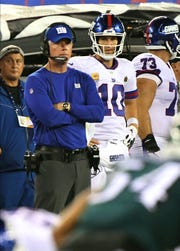 Oct 11, 2018; East Rutherford, NJ, USA;   New York Giants head coach Pat Shurmur and Giants quarterback Eli Manning (10) look on late in the fourth quarter against the Philadelphia Eagles at MetLife Stadium.