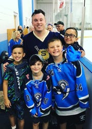 Tom Keough, who coaches youth hockey in Paramus, is pictured with Spartan Elite players (from left) Thomas Keough, Collin Bender, Allen Magie and William Micholas.