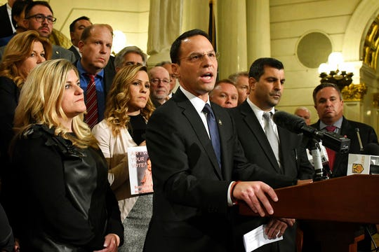 Attorney General Josh Shapiro of Pennsylvania speaks at a news conference in the state Capitol after legislation to respond to a landmark grand jury report accusing hundreds of Roman Catholic priests of sexually abusing children over decades stalled in the Legislature, Wednesday, Oct. 17, 2018 in Harrisburg, Pa. Shapiro is flanked by lawmakers and victims of child sexual abuse.