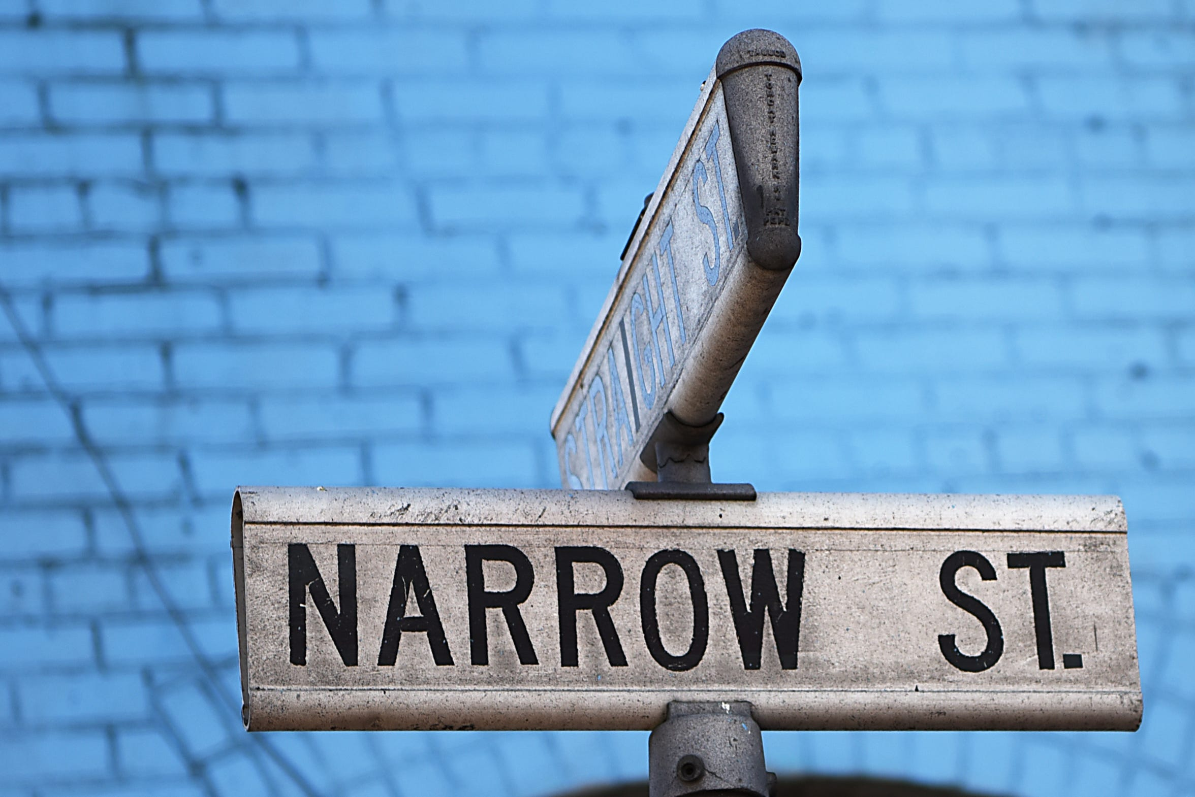 The Straight Street and Narrow Street signs in Paterson on Thursday, Oct. 18, 2018. The corner gave the organization its name.