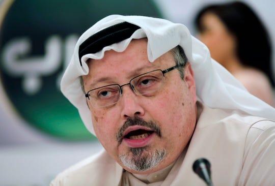 Saudi journalist Jamal Khashoggi speaks during a press conference in Manama, Bahrain, in 2015.