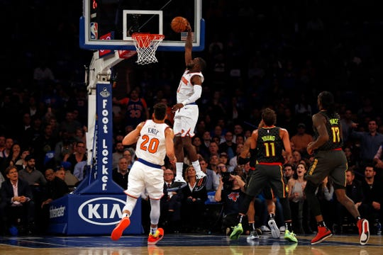 Oct 17, 2018; New York, NY, USA; New York Knicks guard Tim Hardaway Jr. (3) dunks the ball against the Atlanta Hawks during the first half at Madison Square Garden.