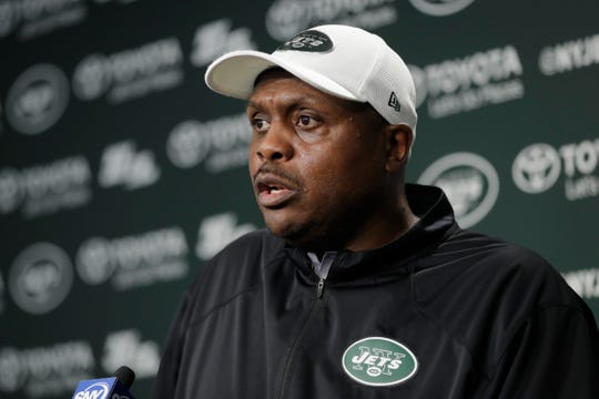 """FILE - In this May 23, 2017, file photo, New York Jets defensive coordinator Kacy Rodgers talks to reporters during the team's organized team activities at its NFL football training facility, in Florham Park, N.J. New York Jets defensive coordinator Kacy Rodgers says he is feeling better following a """"procedure"""" to help deal with an unspecified illness.  Rodgers returned to work this week on a full-time basis after missing the team's last two games."""