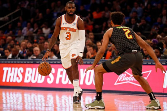 Oct 17, 2018; New York, NY, USA; New York Knicks guard Tim Hardaway Jr. (3) looks to pass around Atlanta Hawks guard Tyler Dorsey (2) during the second half at Madison Square Garden. Mandatory Credit: Adam Hunger-USA TODAY Sports
