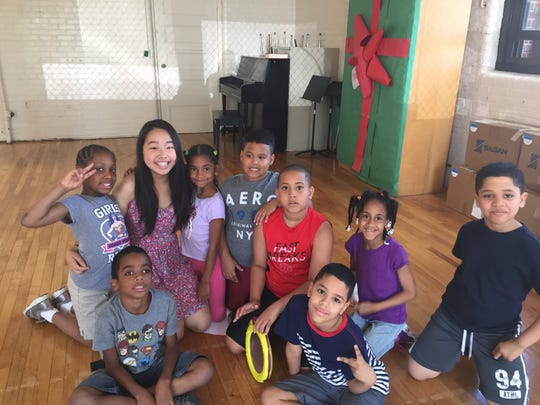 Bergen County Academies senior Jenn Lee and her Paterson Music Academy students.