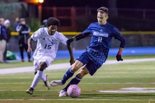 Paramus #11 Nick Sallemi advancing the ball against Hackensack on Wednesday, October 17, 2018.