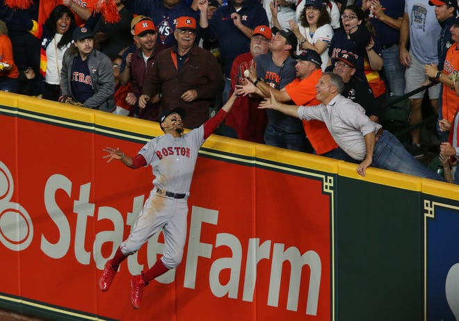 Oct 17, 2018; Houston, TX, USA; Houston Astros second baseman Jose Altuve (27, not pictured) is called out after a fan interfered with Boston Red Sox right fielder Mookie Betts (50) catch during the first inning in game four of the 2018 ALCS playoff baseball series at Minute Maid Park. Mandatory Credit: Troy Taormina-USA TODAY Sports