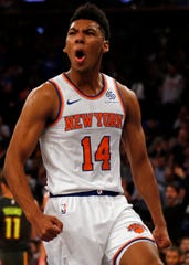 Oct 17, 2018; New York, NY, USA; New York Knicks guard Allonzo Trier (14) reacts after scoring a basket against the Atlanta Hawks during the second half at Madison Square Garden. Mandatory Credit: Adam Hunger-USA TODAY Sports