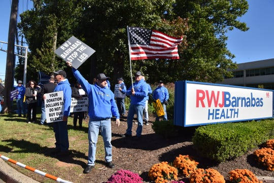 Members of Brothers Before Others along with other groups protest at Robert Wood Johnson Barnabas Health in West Orange, demanding the hospital leadership to acknowledge the anti-police statements by Executive Vice President Michellene Davis are baseless, inflammatory and threaten the safety of police officers.