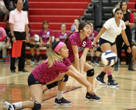 Junior Krista Jimenez and senior Kari Dominguez (5) stay down for the dig as senior libero Kianna Gomez looks on for the Lady 'Cats.