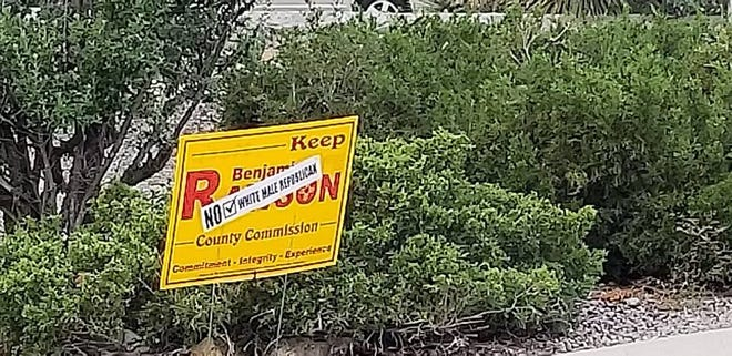 Campaign sign of County Commission candidate Benjamin Rawson that was defaced.