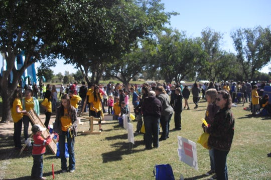 People gather for Carlsbad's Fallapalooza. This year's popular family event starts Saturday at 10 a.m. the Beach Band Shell area.
