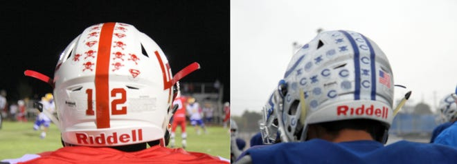 Loving sophomore Hunter Hernandez' helmet, left, and Carlsbad senior Tate Collins' helmet. The different stickers on their helmets represent different goals accomplished throughout the season.