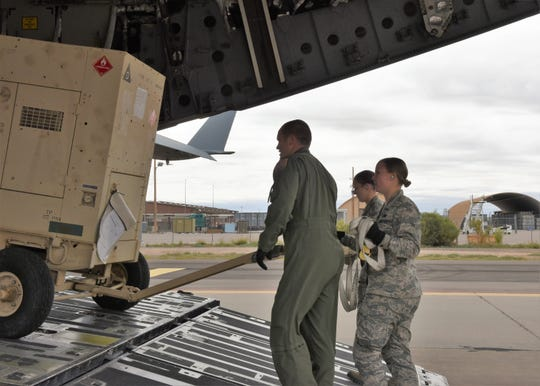 The 49th Logistics Readiness Squadron and 635th Materiel Maintenance Group Airmen load equipment onto a C-17 Globemaster III, assigned to the Memphis Air National Guard on the flight line at Holloman Air Force Base, N.M., on Oct. 15, 2018. The Airmen of the 49th LRS and 635 MMG dedicatded over 7,00 man-hours to recent airlift operations in support of Tyndall Air Force Base, Fla., in response to the devistation of Hurricane Michael.