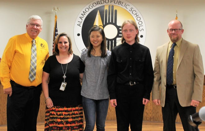"""APS has three National Merit Semifinalists this year who were recognized at the regular APS Board meeting Wednesday. From left: APS Board President David Weaver, Shawna Denney of the AHS College Prep Academy, National Merit Semifinalists Melanie Jun and Charles """"Trey"""" Wisecup and APS Acting Superintendent Jerrett Perry. Not pictured is Brian Colon-Ortiz who was unable to be at the APS Board meeting Wednesday."""