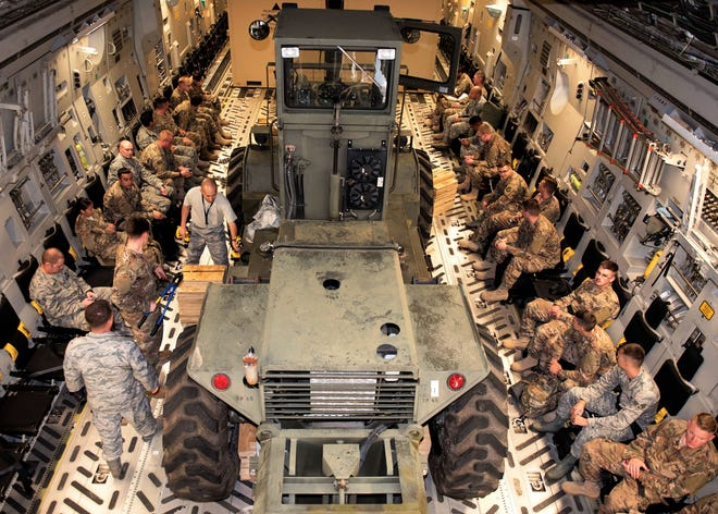 Airmen from the 635th Materiel Maintenance Group board a C-17 Globemaster III assigned to Joint Base Lewis-McChord, Wash. at Holloman Air Force Base, N.M., Oct. 13, 2018. The 49th Logistics Readiness Squadron supported Airmen from the 635th MMG in a recent operation to send essential supplies and personnel to Tyndall Air Force Base, Panama City, Fl.