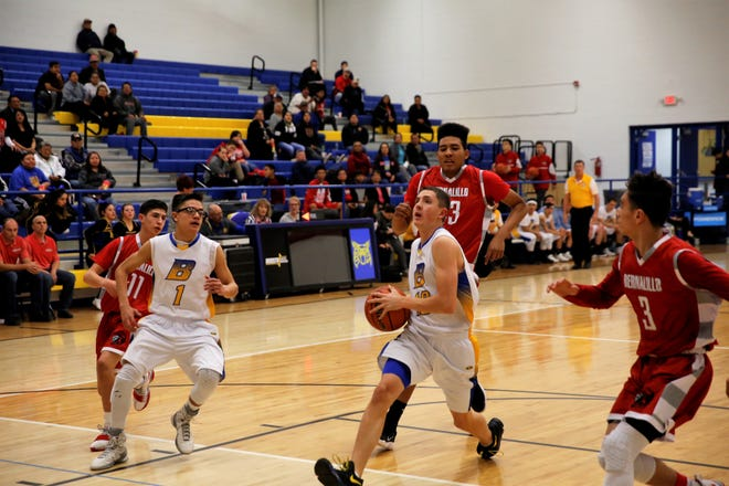 Bloomfield's Josh Boehm (10) drives to the basket during a nondistrict game against Bernalillo on Jan. 2 at Bobcat Gym. Bloomfield opens the new season Nov. 29 at the Jerry Richardson Memorial tournament in Shiprock.