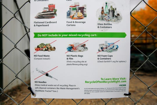 A sign posted at the Waste Management recycling facility in Farmington informs users what can and can't be recycled.