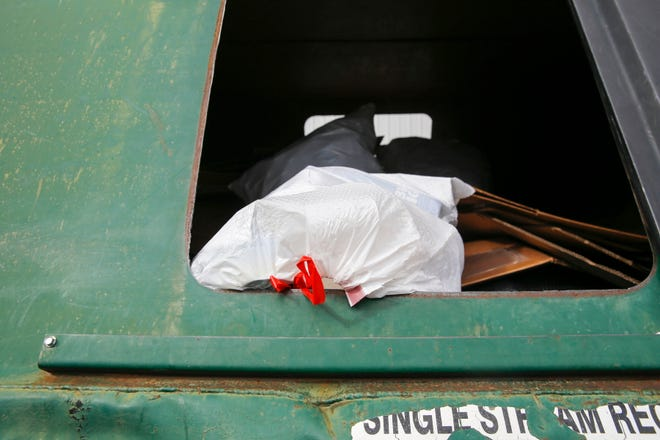 A plastic bag containing recyclables is pictured inside a recycling bin at the Waste Management recycling area, Thursday, Oct. 18, 2018 in Farmington.