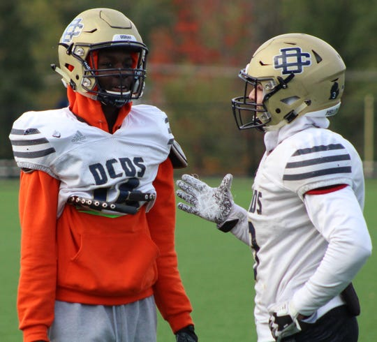 Seniors Darrin King (left) and Anthony Toma engage in a heavy discussion during Wednesday's practice at Detroit Country Day.